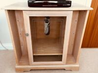 Limed oak tv unit with glass front