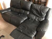 Three seater black reclining sofa