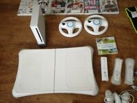 Wii console and Wii fit 18 games 3 remotes and 3 nun chunk