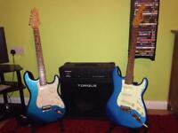 Two electric guitars and torque amp.