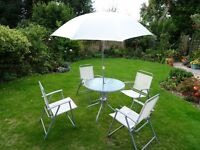 PAtio set of table, four chairs and umbrella