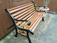 REFURBISHED CAST IRON AND HARDWOOD GARDEN BENCH.