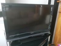 """Sony 32"""" TV, DVD Player and surround sound"""