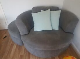Swivel armchair with footstool