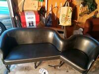 Black leather 'one of a kind' sofa/chair