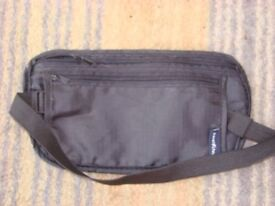 Brand new bum bag with elasticated strap. Black with 2 zipped compartments. Can be posted.Very thin.