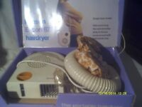 A HAIR DRYER In V.G.C. TOGETHER with HOSE & HOOD If REQUIRED all In ORIGINAL BOX .