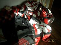 Used motorcycle leathers, jacket, trousers, and body armour. medium size, 42 trouser size