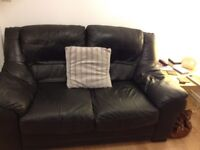 Two seater black leather sofa and armchair
