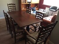 Solid Dark Wood Rectangular Table and Six Chairs, including two 'carver' chairs