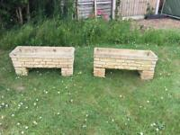 A pair of large vintage 1960's sandford stone trough garden planters with matching feet.