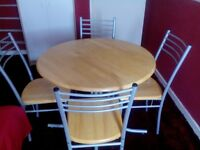 round pine dining table with four chairs