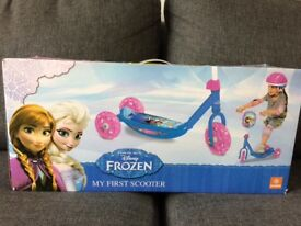 Brand new, never been opened Frozen three wheel scooter with matching attached Frozen bag. In box.