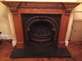 Living flame cast iron fire with wood fireplace