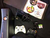 XBOX 360 S, 64 games, 2 controllers, 4 rechargeable batteries with charger