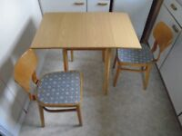 Kitchen table and three matching chairs
