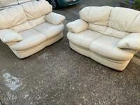 Cream leather 2x2 seater sofas in very good condition