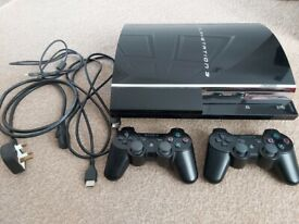 PS3 bundle (phat console upgraded to 300GB). 19 games, with 2 controllers, plus Buzz controllers.