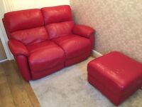 Sofa. Two seater red leather recliner and foot stool.