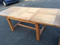Solid oak extending dining table from David Phillips furniture I can deliver