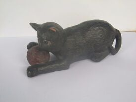 A Bretby cat and ball figure - marked Bretby 1518