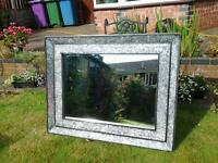 Large modern heavy, black and silver mirror