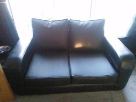 Black & purple 3 & 2 seater sofa in reversible black leather or purple fabric