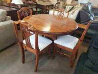 Ducal pine round table and four chairs