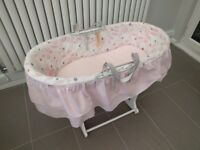Moses basket with mattress, base, and pink covers