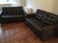 2 x two seater black leather sofas