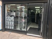 SHOP WITH 3 bedroom onsite parking long lease Main Road