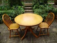 Table, compact size, and two chairs, solid hard wood, very good condition