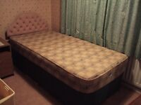 Single bed with headboard