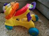 Fisher Price ride on push Lion walker