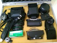 Bronica ETRS medium format camera, standard (75mm) & 150mm lenses; backs and finders in fitted case.