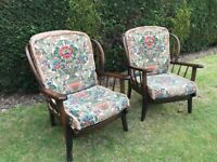 ERCOL STYLE PAIR OF ARMCHAIRS WITH CUSHIONS. VERY SOUND AND IN GOOD CONDITION.