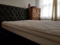 King size bed with a memory foam mattress