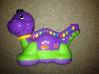 Leap frog lettersaurus learning toy.