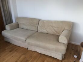 large beige IKEA sofa and armchair