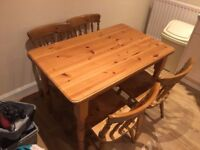 Pine dining table and four chairs nice solid quality items