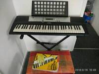 Keyboard Yamaha psr e203 with stand and chair.