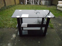 SMALL COFFE/TV STAND BLACK GLASS, EXCELLENT CONDITION