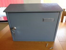Grey outdoor, metal, weatherproof letterbox, mounts onto wall. £5