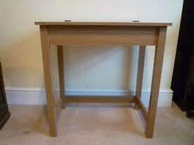 Children's Desk from Argos with lifting lid and storage within.
