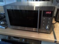 large stainless steel microwave oven in excellent condition