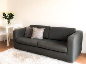 Habitat grey sofa bed for sale.