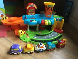 Vtech Toot Toot Drivers Garage - includes 4 or 5 vehicles