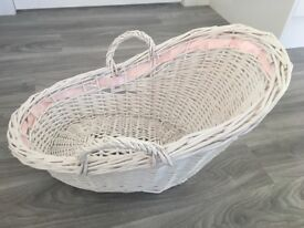 White wicker baby basket photography prop for newborn photo shoot