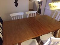 Wooden dining table, extendable. £20
