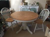Solid wood table and arrowback chairs